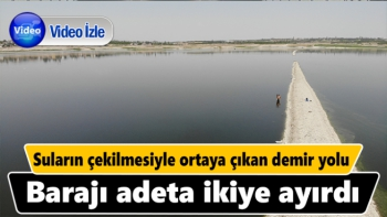 Suların çekilmesiyle ortaya çıkan demir yolu, barajı adeta ikiye ayırdı