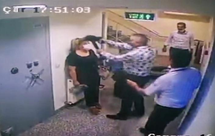 Banka müdürünün başına silah dayadığı kadın: